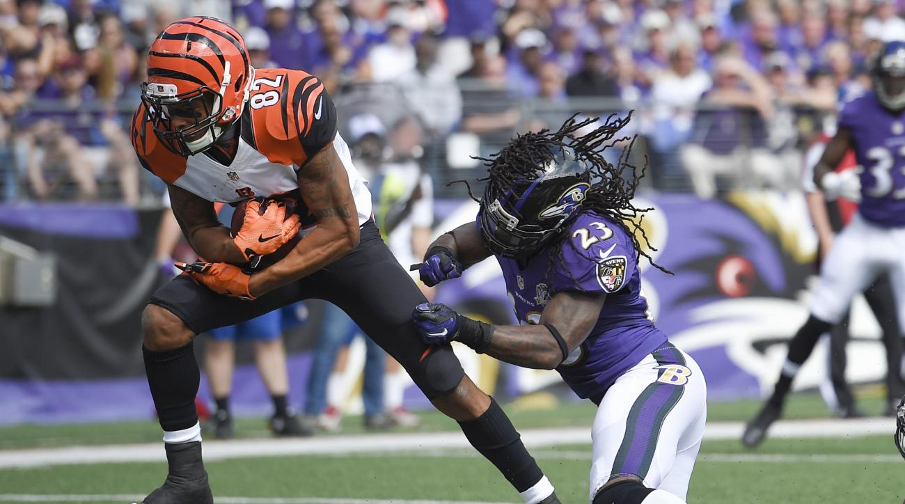 Cincinnati Bengals wide receiver Marvin Jones (82) gets past Baltimore Ravens free safety Kendrick Lewis (23) to score a touchdown during the first half of an NFL football game in Baltimore, Sunday, Sept. 27, 2015. (AP Photo/Nick Wass)