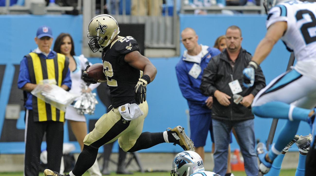 New Orleans Saints' Mark Ingram (22) runs past Carolina Panthers' Josh Norman (24) for a touchdown in the first half of an NFL football game in Charlotte, N.C., Sunday, Sept. 27, 2015. (AP Photo/Mike McCarn)