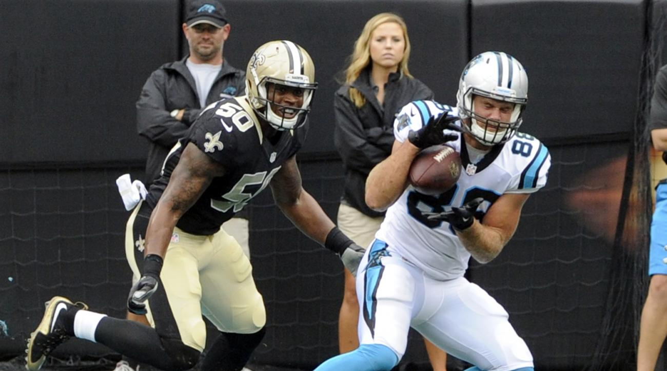 Carolina Panthers' Greg Olsen (88) catches a touchdown pass as New Orleans Saints' Stephone Anthony (50) defends in the first half of an NFL football game in Charlotte, N.C., Sunday, Sept. 27, 2015. (AP Photo/Mike McCarn)