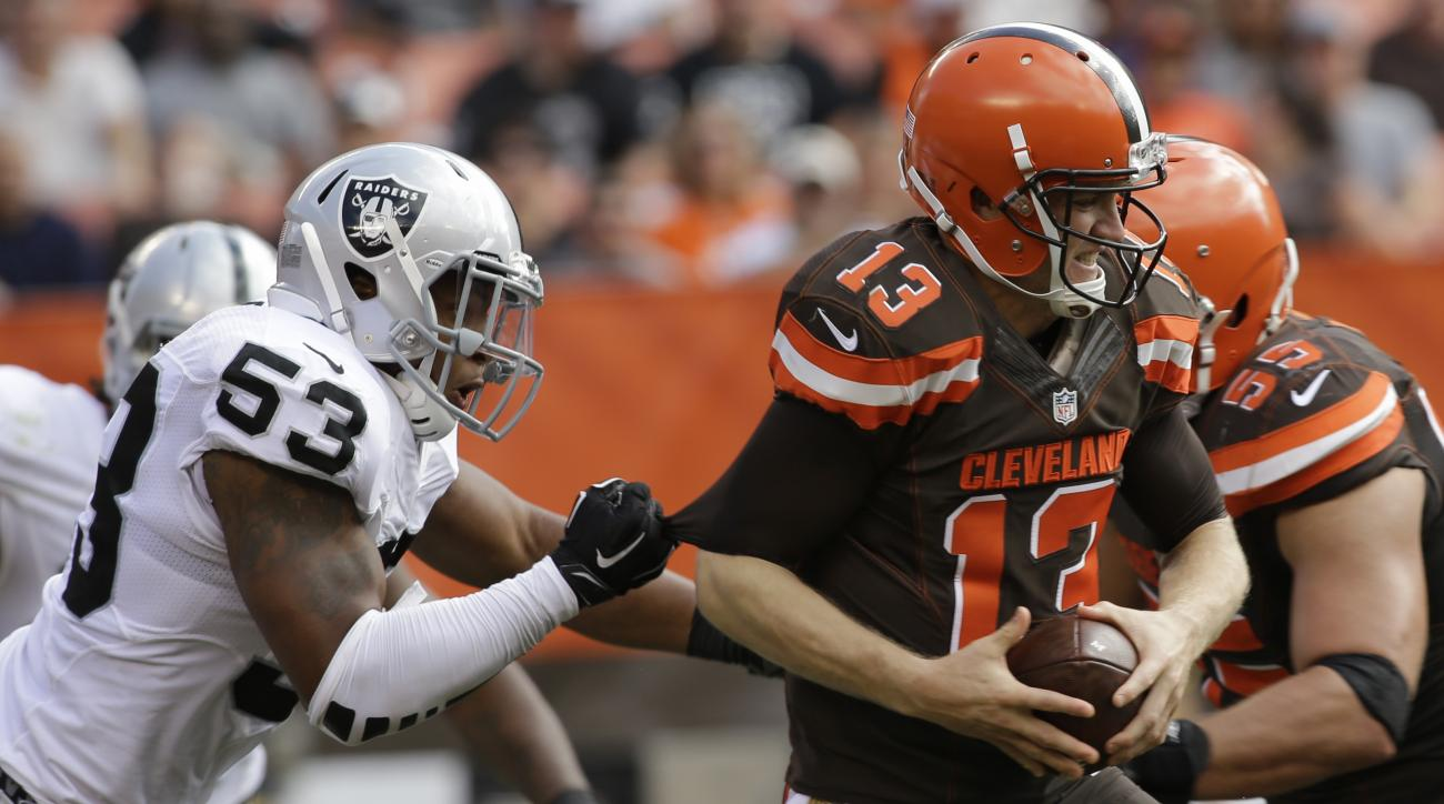 Oakland Raiders outside linebacker Malcolm Smith (53) puts pressure on Cleveland Browns quarterback Josh McCown (13) before making a sack in the second half of an NFL football game, Sunday, Sept. 27, 2015, in Cleveland. (AP Photo/Aaron Josefczyk)