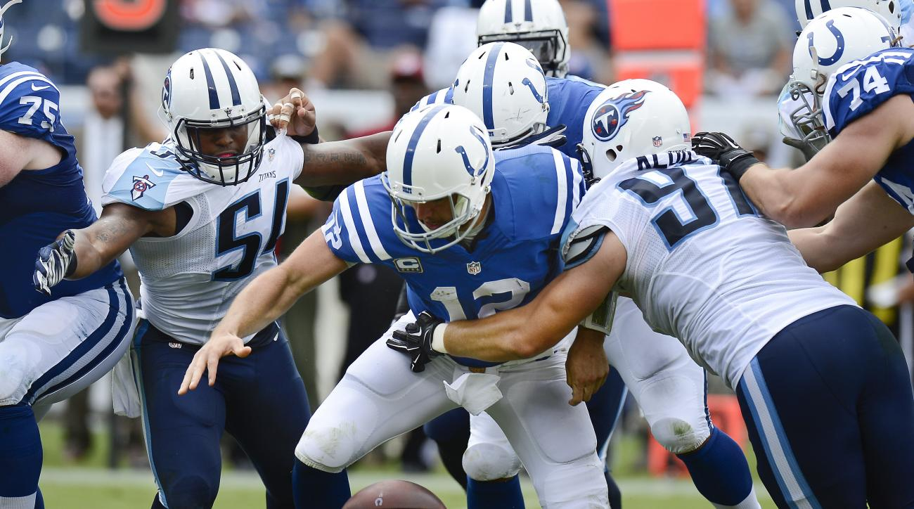 Indianapolis Colts quarterback Andrew Luck (12) fumbles the ball as he is hit by Tennessee Titans defensive end Karl Klug (97) in the second half of an NFL football game Sunday, Sept. 27, 2015, in Nashville, Tenn. Luck recovered the ball. (AP Photo/Mark Z