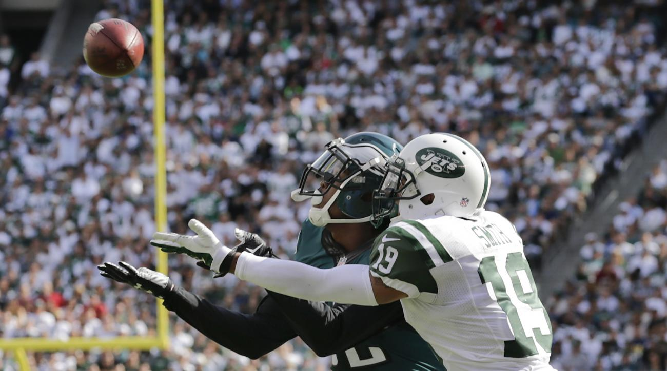 Philadelphia Eagles cornerback Eric Rowe (32) reaches back to intercept a pass intended for New York Jets wide receiver Devin Smith (19) during the third quarter of an NFL football game, Sunday, Sept. 27, 2015, in East Rutherford, N.J. (AP Photo/Adam Hung