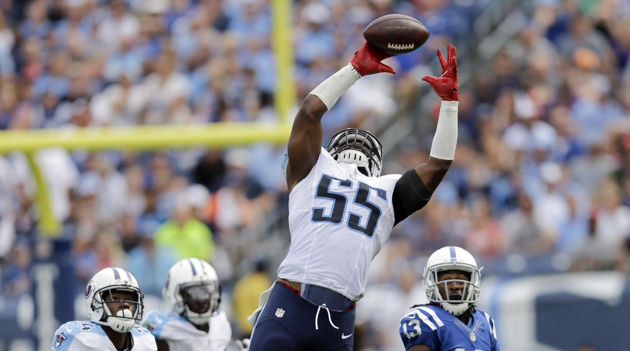 Tennessee Titans inside linebacker Zach Brown (55) intercepts a pass in front of Indianapolis Colts wide receiver T.Y. Hilton (13) in the second half of an NFL football game Sunday, Sept. 27, 2015, in Nashville, Tenn. (AP Photo/James Kenney)
