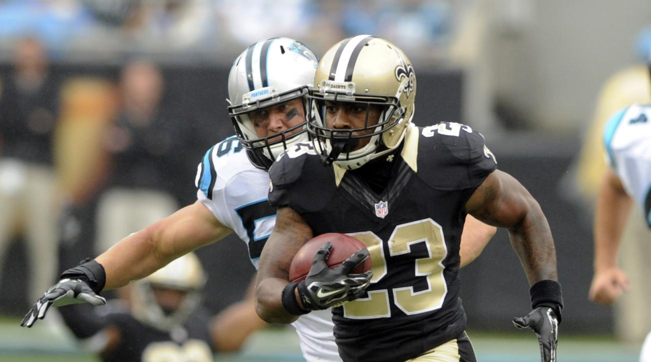 New Orleans Saints' Marcus Murphy (23) returns a punt for a touchdown against the Carolina Panthers during the second half of an NFL football game in Charlotte, N.C., Sunday, Sept. 27, 2015. (AP Photo/Mike McCarn)