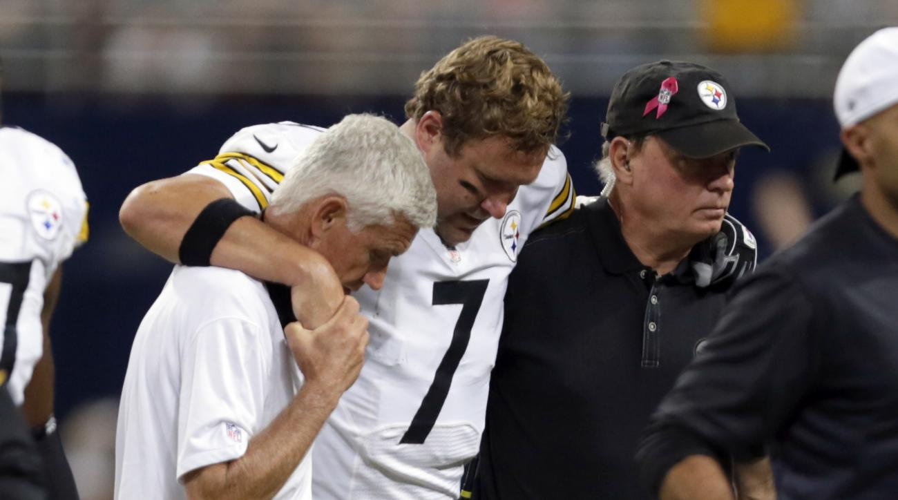 Pittsburgh Steelers quarterback Ben Roethlisberger is helped off the field after being injured during the third quarter of an NFL football game against the St. Louis Rams, Sunday, Sept. 27, 2015, in St. Louis. (AP Photo/Tom Gannam)