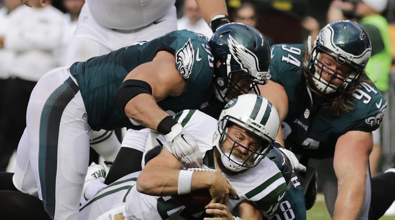 New York Jets quarterback Ryan Fitzpatrick (14) is sacked by Philadelphia Eagles linebacker Marcus Smith (90) and outside linebacker Jordan Hicks (58) during the fourth quarter of an NFL football game, Sunday, Sept. 27, 2015, in East Rutherford, N.J. (AP