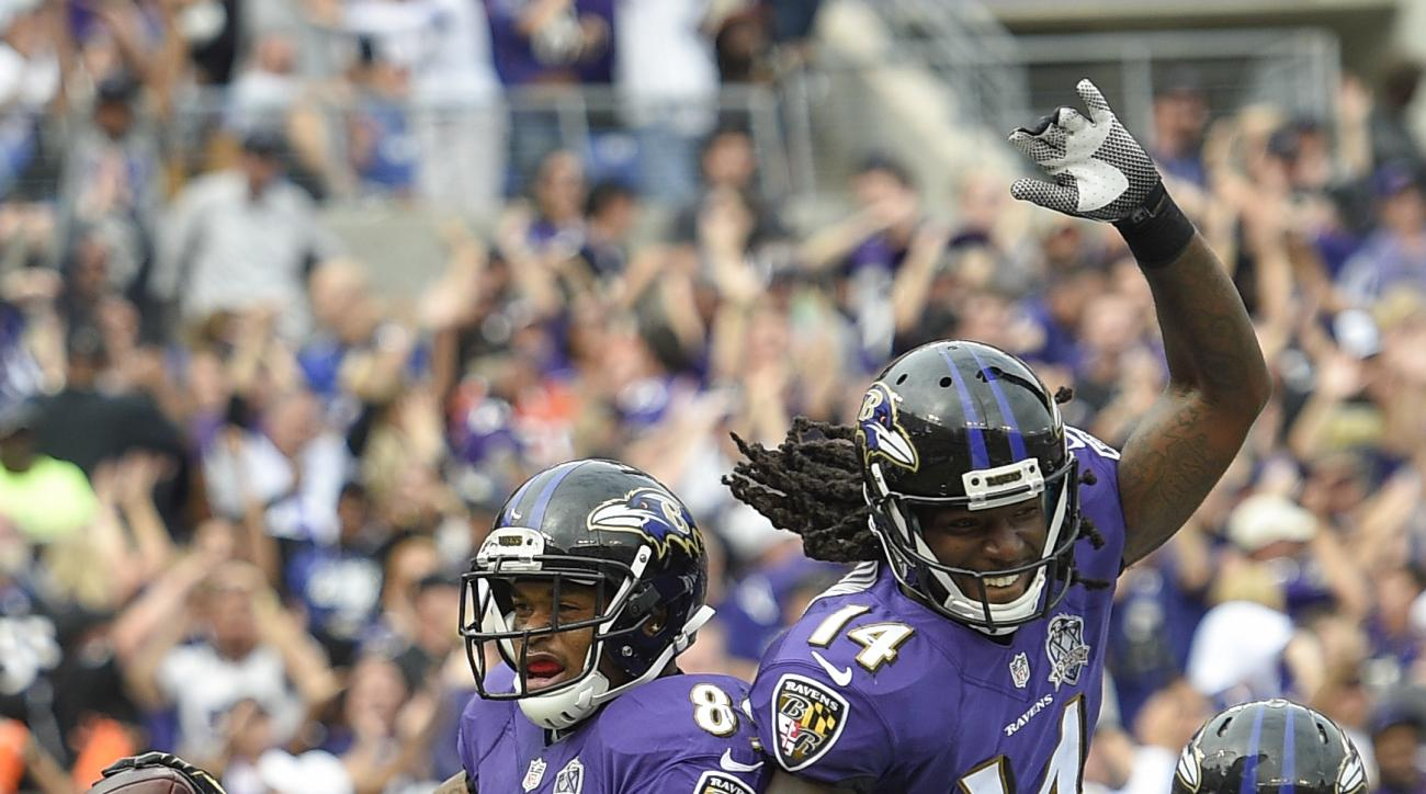 Baltimore Ravens wide receiver Steve Smith (89) celebrates his touchdown with wide receiver Marlon Brown (14) during the second half of an NFL football game against the Cincinnati Bengals in Baltimore, Sunday, Sept. 27, 2015. (AP Photo/Nick Wass)