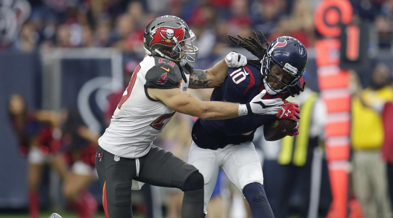 Houston Texans' DeAndre Hopkins (10) makes a catch in front of Tampa Bay Buccaneers' Chris Conte (23) during the second half of an NFL football game Sunday, Sept. 27, 2015, in Houston. (AP Photo/David J. Phillip)