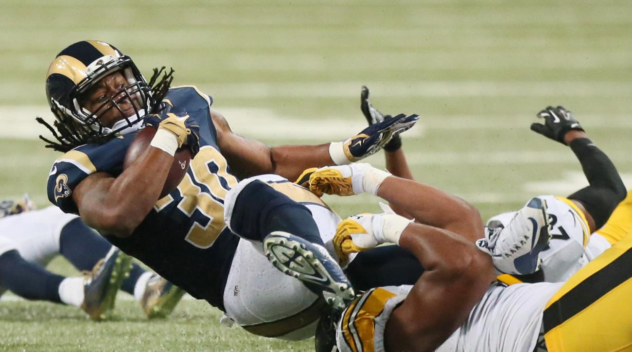 St. Louis Rams running back Todd Gurley is tackled by Pittsburgh Steelers defensive end Stephon Tuitt in the second quarter of an NFL football game on Sunday, Sept. 27, 2015, at the Edward Jones Dome in St. Louis.  (Chris Lee/St. Louis Post-Dispatch via A