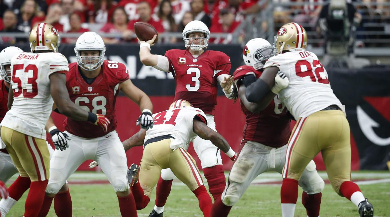Arizona Cardinals quarterback Carson Palmer (3) throws against the San Francisco 49ers during the second half of an NFL football game, Sunday, Sept. 27, 2015, in Glendale, Ariz. (AP Photo/Ross D. Franklin)