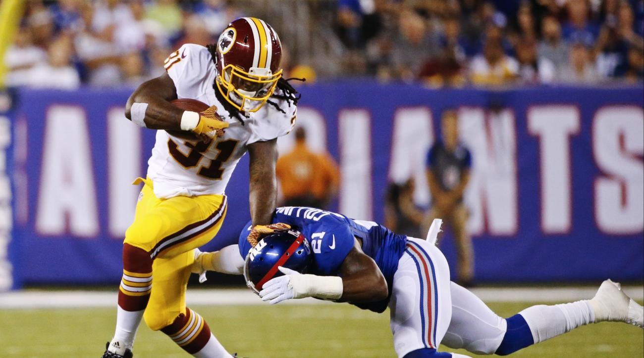 FILE - In this Sept. 24, 2015 file photo, Washington Redskins running back Matt Jones (31) stiff arms New York Giants' Landon Collins (21) during the first half an NFL football game in East Rutherford, N.J.  Coach Jay Gruden and the Redskins get back to w