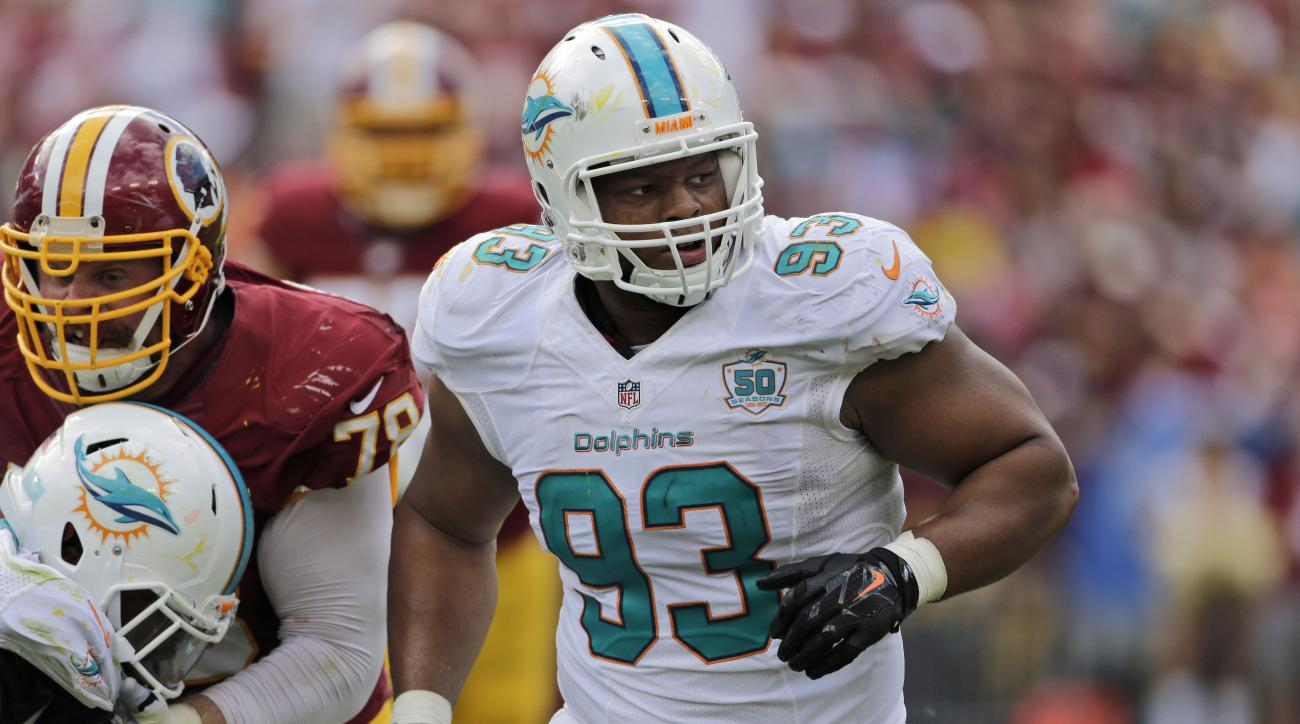 FILE - In this  Sunday, Sept. 13, 2015 file photo, Miami Dolphins defensive tackle Ndamukong Suh (93) rushes during the second half of an NFL football game against the Washington Redskins in Landover, Md.  Todd Bowles has figured out the key to slowing Nd