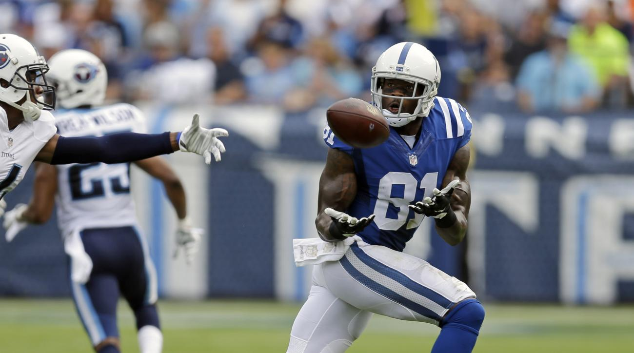 FILE - In this Sept. 27, 2015, file photo, Indianapolis Colts wide receiver Andre Johnson (81) catches a pass against the Tennessee Titans in the second half of an NFL football game in Nashville, Tenn. The Colts signed Andre Johnson to give the offense a