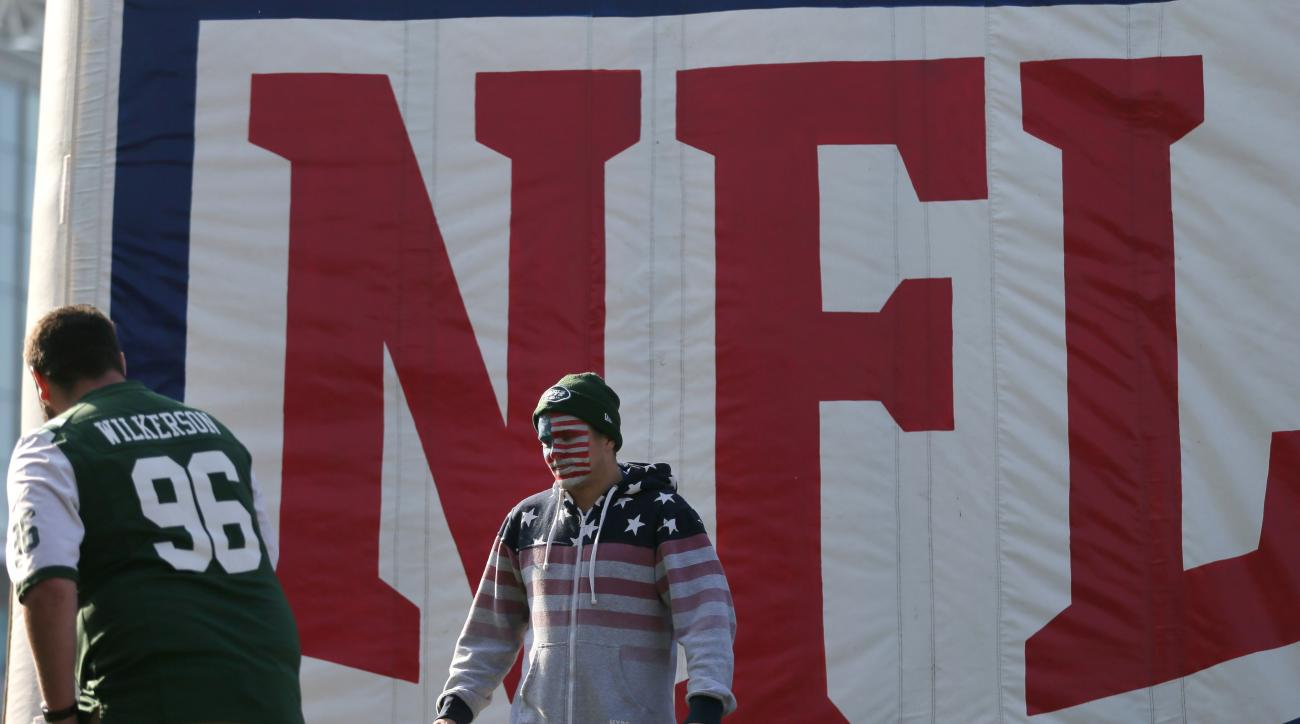 Spectators take photos on Wembley Way as they arrive for the NFL football game between the New York Jets and the Miami Dolphins and at Wembley stadium in London, Sunday, Oct. 4, 2015. (AP Photo/Tim Ireland)