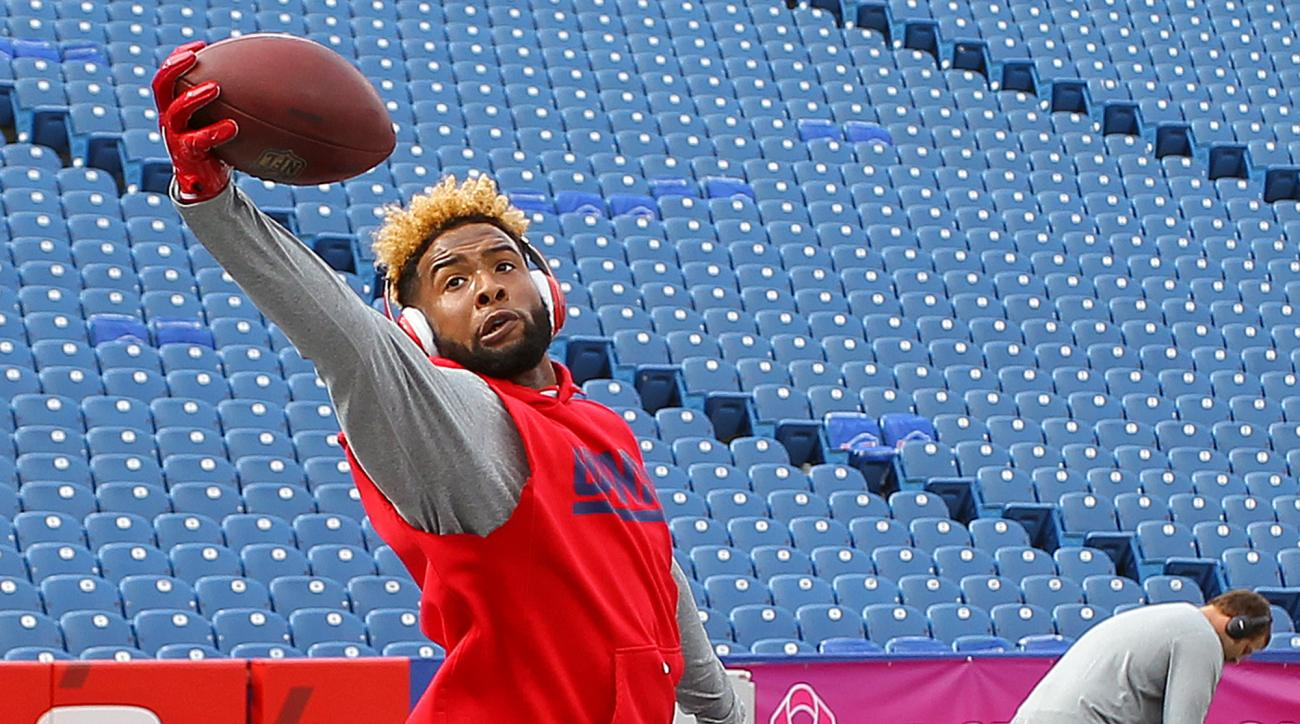 New York Giants wide receiver Odell Beckham works on his one-handed catches prior to an NFL football game against the Buffalo Bills, Sunday, Oct. 4, 2015, in Orchard Park, N.Y. (AP Photo/Bill Wippert)