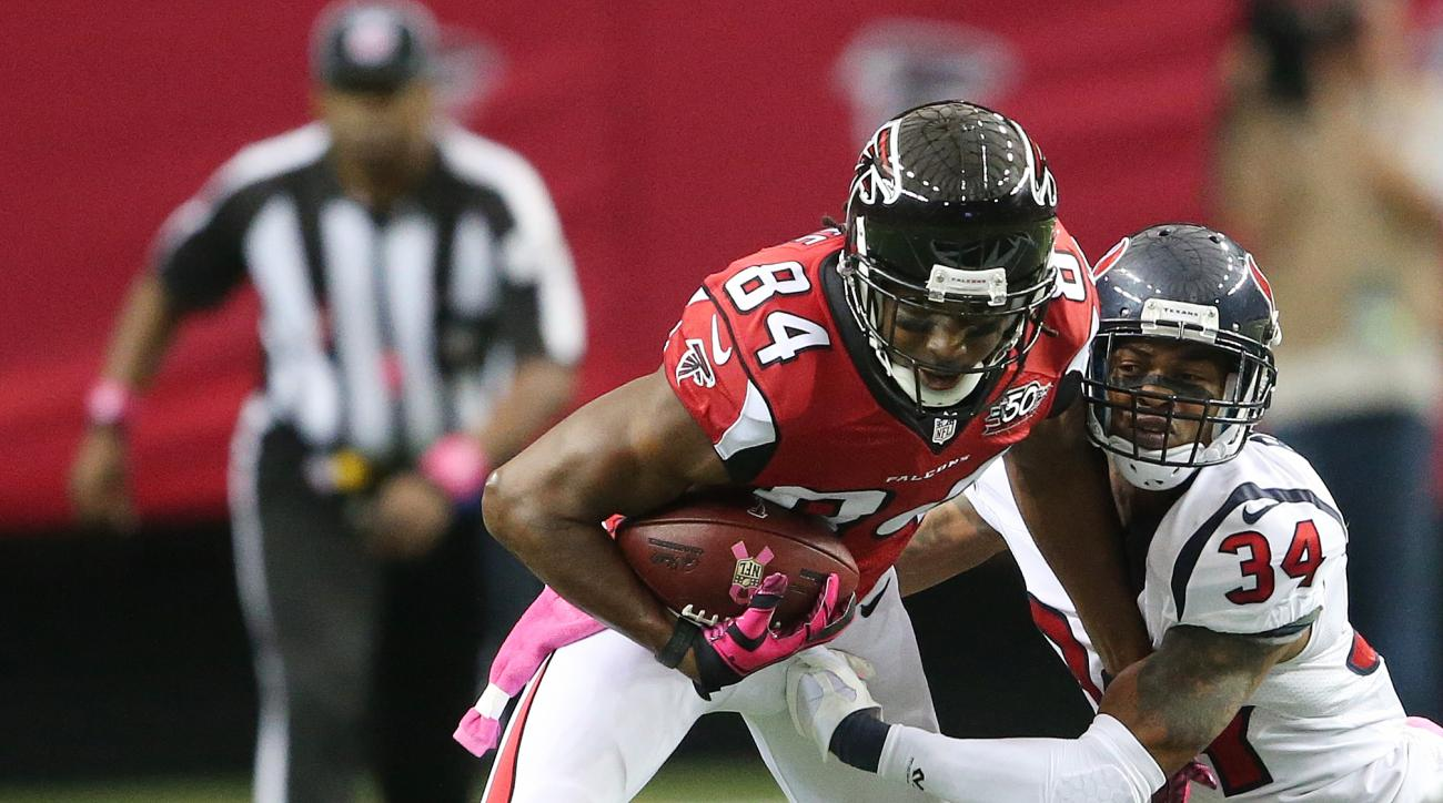 Atlanta Falcons wide receiver Roddy White (84) makes the catch against Houston Texans cornerback A.J. Bouye (34) during the first half of an NFL football game, Sunday, Oct. 4, 2015, in Atlanta. (AP Photo/John Bazemore)