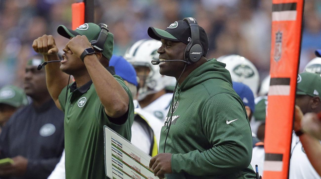 New York Jets head coach Todd Bowles, right, smiles during the NFL football game between the New York Jets and the Miami Dolphins and at Wembley stadium in London, Sunday, Oct. 4, 2015. (AP Photo/Matt Dunham)
