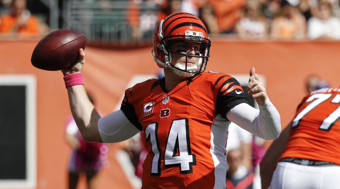 Cincinnati Bengals quarterback Andy Dalton throws in the first half of an NFL football game against the Kansas City Chiefs, Sunday, Oct. 4, 2015, in Cincinnati. (AP Photo/Frank Victores)