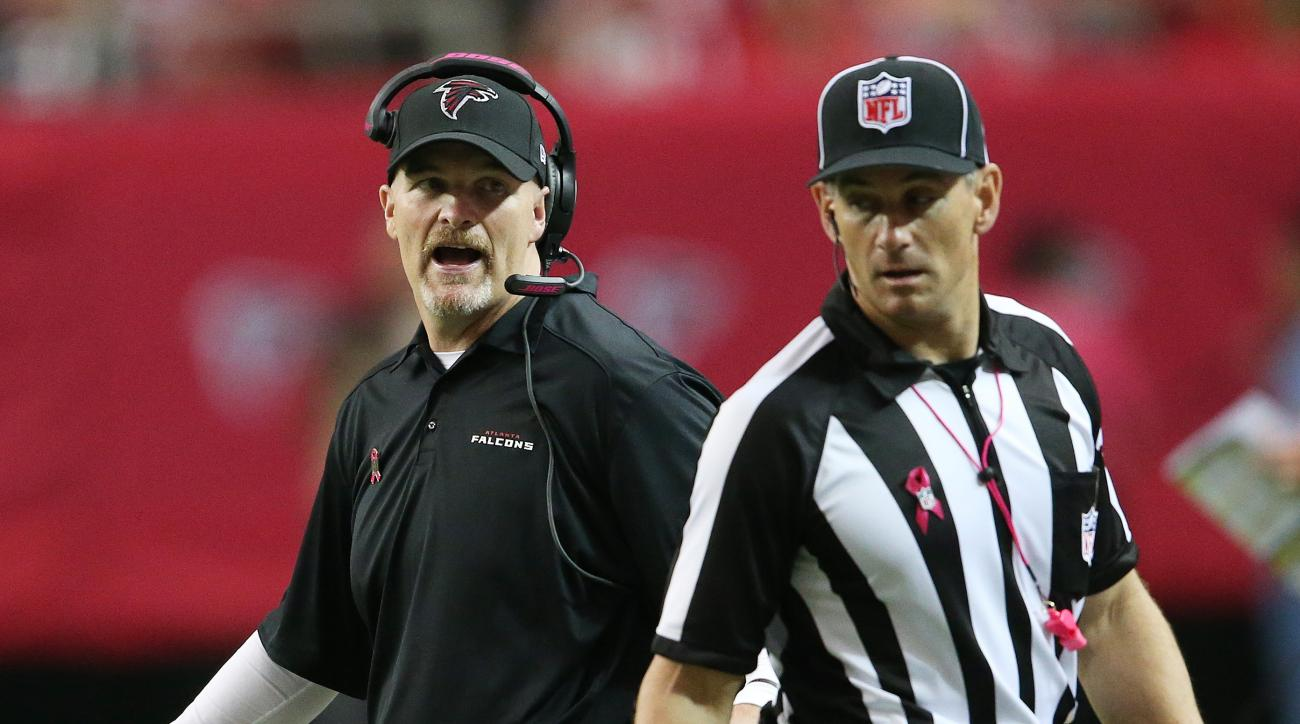 Atlanta Falcons head coach Dan Quinn speaks to an official during the first half of an NFL football game against the Houston Texans, Sunday, Oct. 4, 2015, in Atlanta. (AP Photo/John Bazemore)