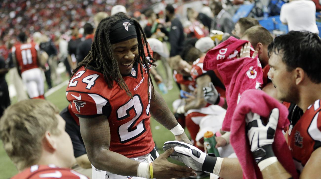 Atlanta Falcons running back Devonta Freeman (24) celebrates his touchdown against the Houston Texans during the second half of an NFL football game, Sunday, Oct. 4, 2015, in Atlanta. (AP Photo/David Goldman)