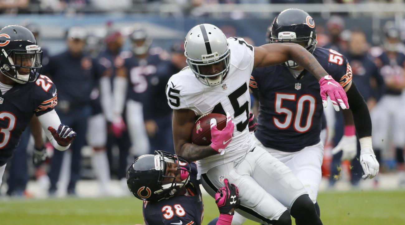 Chicago Bears free safety Adrian Amos (38) tackles Oakland Raiders wide receiver Michael Crabtree (15) during the second half of an NFL football game, Sunday, Oct. 4, 2015, in Chicago. (AP Photo/Charles Rex Arbogast)