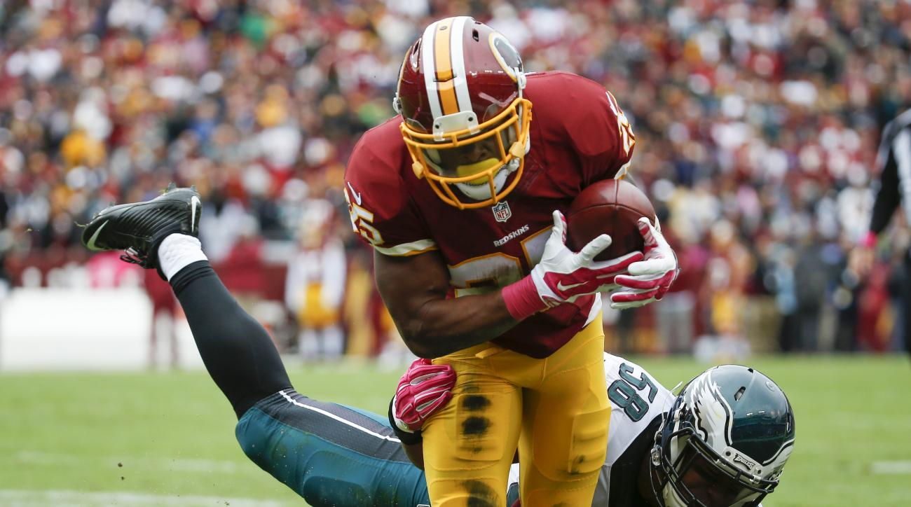 Washington Redskins running back Chris Thompson (25) is stopped short of the goal line by Philadelphia Eagles outside linebacker Jordan Hicks (58) during the first half of an NFL football game in Landover, Md., Sunday, Oct. 4, 2015. (AP Photo/Alex Brandon
