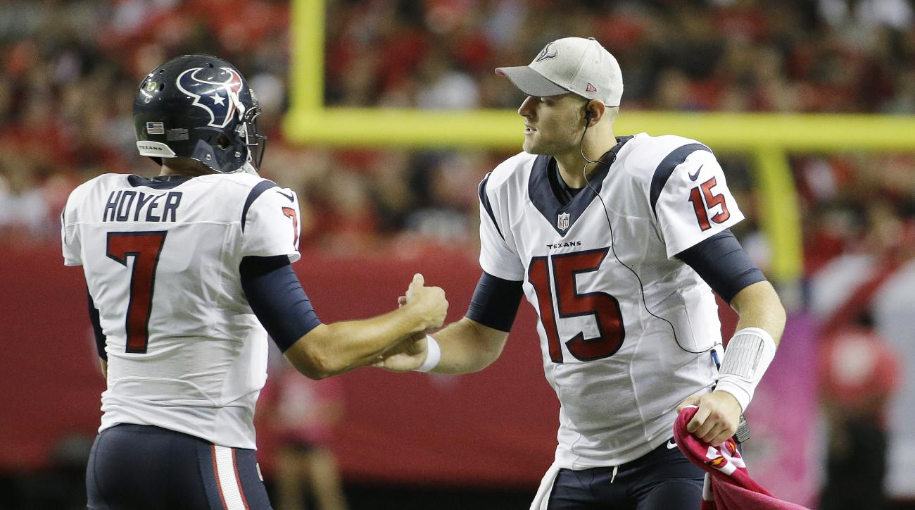 Houston Texans quarterback Ryan Mallett (15) congratulates Houston Texans quarterback Brian Hoyer (7) after Hoyer through a touchdown passs against the Atlanta Falcons during the second half of an NFL football game, Sunday, Oct. 4, 2015, in Atlanta. (AP P
