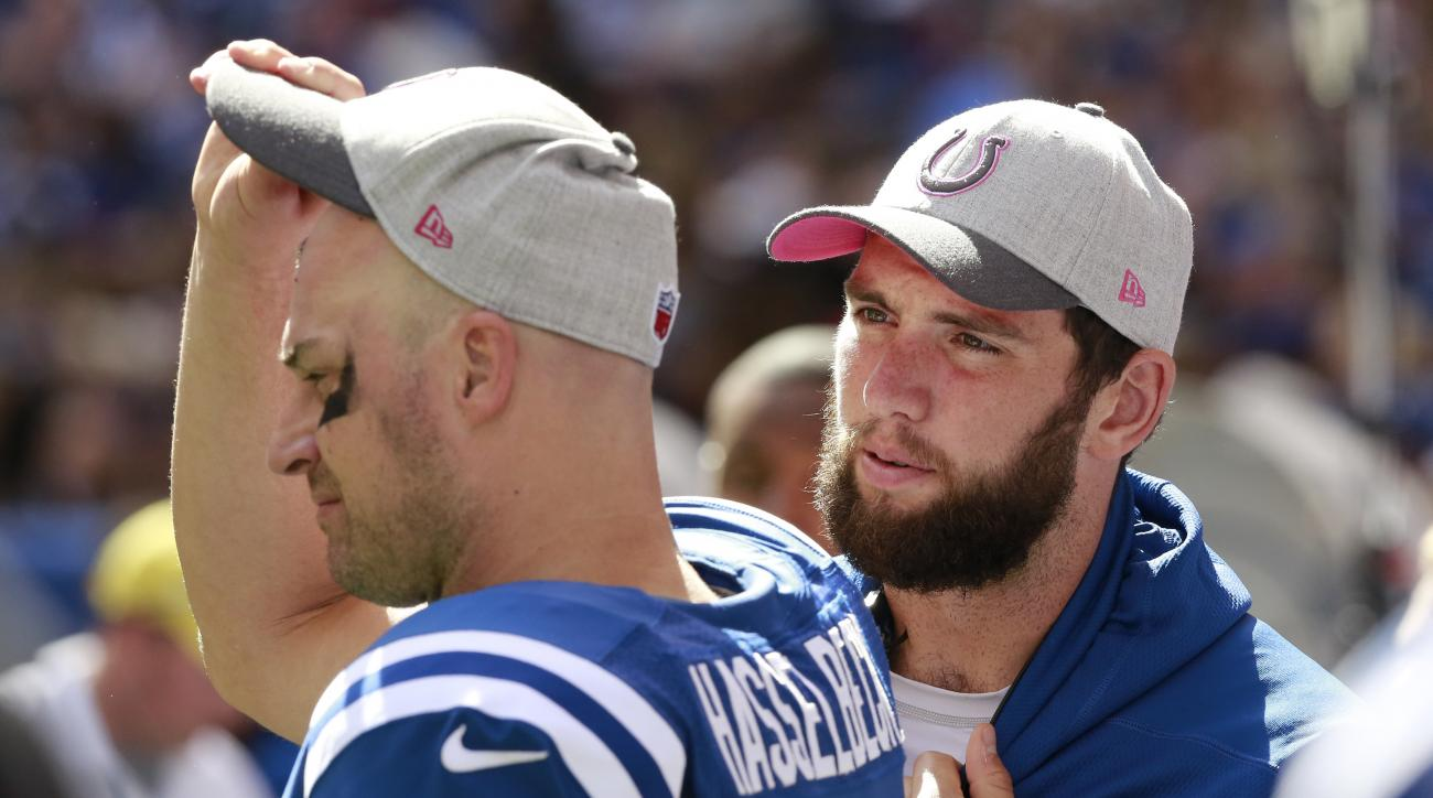 Indianapolis Colts' Andrew Luck, right, talks with quarterback Matt Hasselbeck (8) during the first half of an NFL football game against the Jacksonville Jaguars, Sunday, Oct. 4, 2015, in Indianapolis. (AP Photo/R Brent Smith)