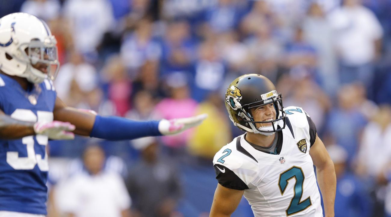 Jacksonville Jaguars' Jason Myers (2) watches as he misses a potential game winning field goal as Indianapolis Colts' Josh Thomas (35) reacts late in the second half of an NFL football game Sunday, Oct. 4, 2015, in Indianapolis. (AP Photo/Michael Conroy)