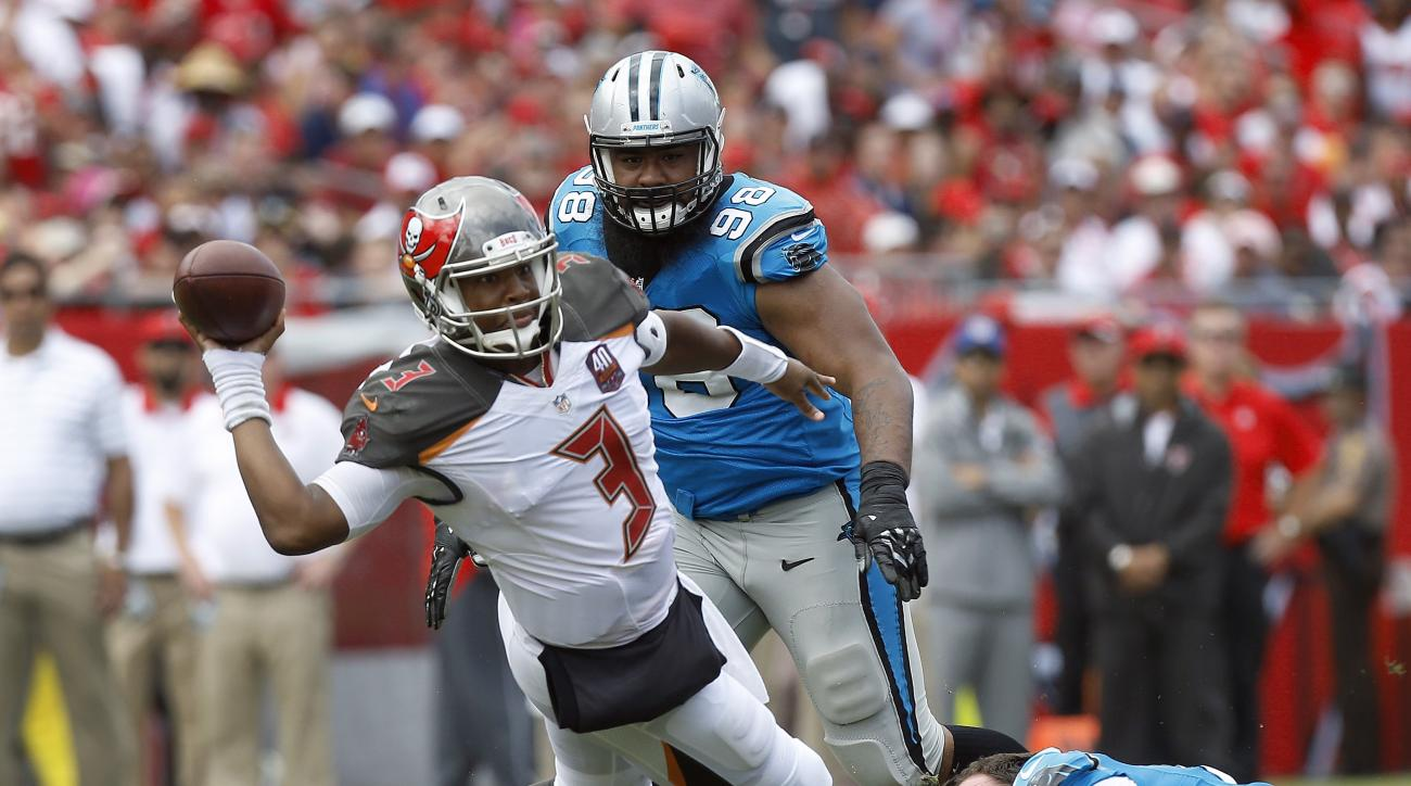 Tampa Bay Buccaneers quarterback Jameis Winston (3) loses his balance after getting tripped up by Carolina Panthers' Jared Allen (69) and Star Lotulelei (98) during the third quarter of an NFL football game Sunday, Oct. 4, 2015, in Tampa, Fla. (AP Photo/B
