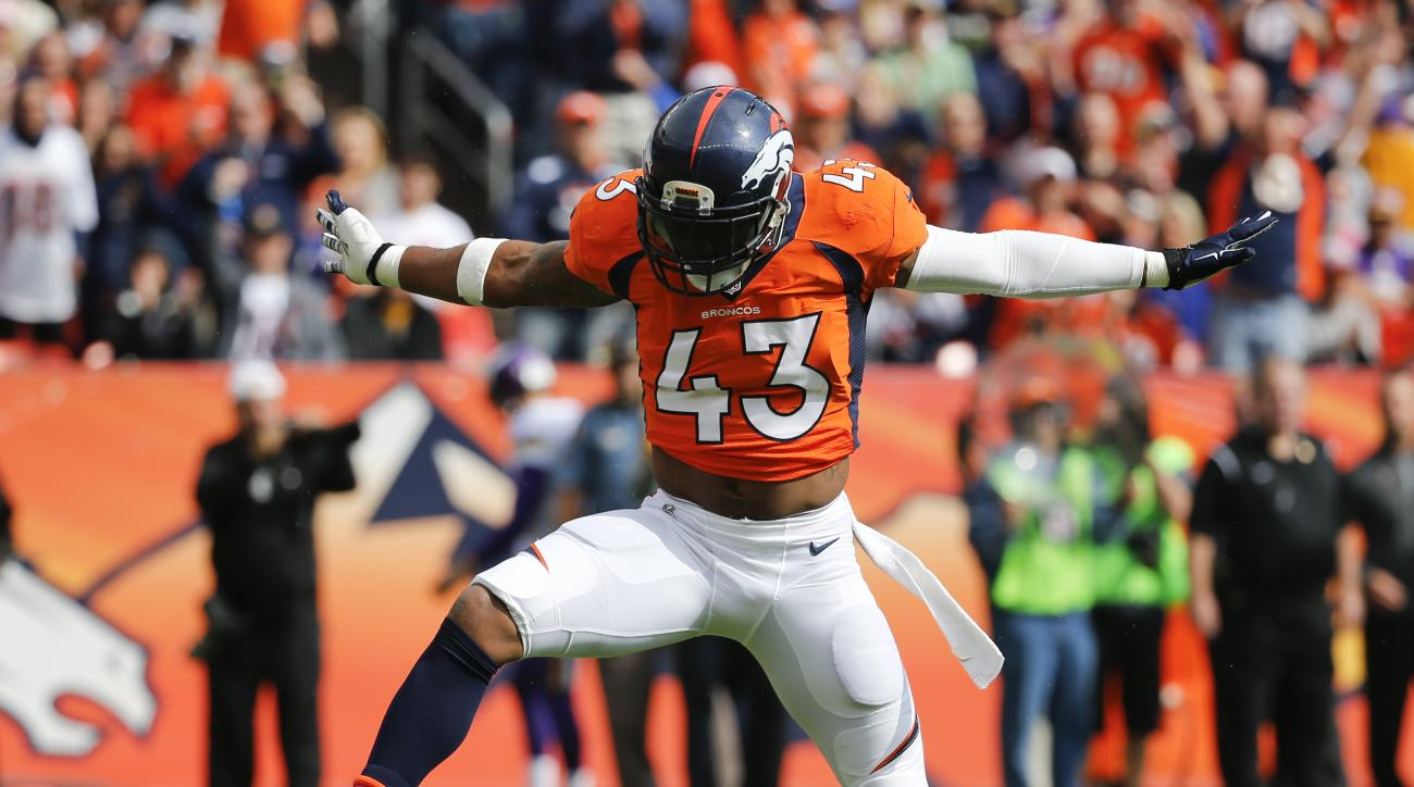 Denver Broncos strong safety T.J. Ward celebrates a sack against the Minnesota Vikings during the first half of an NFL football game, Sunday, Oct. 4, 2015, in Denver. (AP Photo/Jack Dempsey)