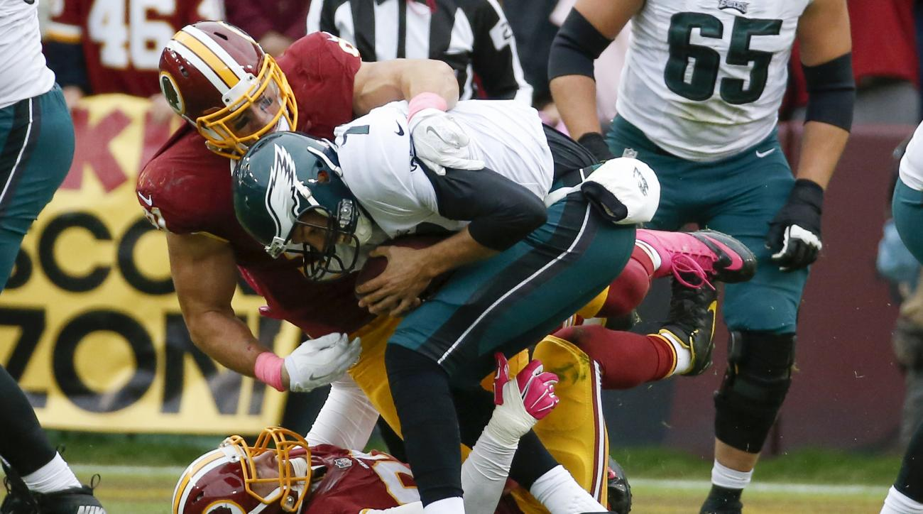 Washington Redskins outside linebacker Ryan Kerrigan (91) and outside linebacker Trent Murphy (93) sack Philadelphia Eagles quarterback Sam Bradford (7) in the closing seconds of an NFL football game in Landover, Md., Sunday, Oct. 4, 2015. The Redskins de