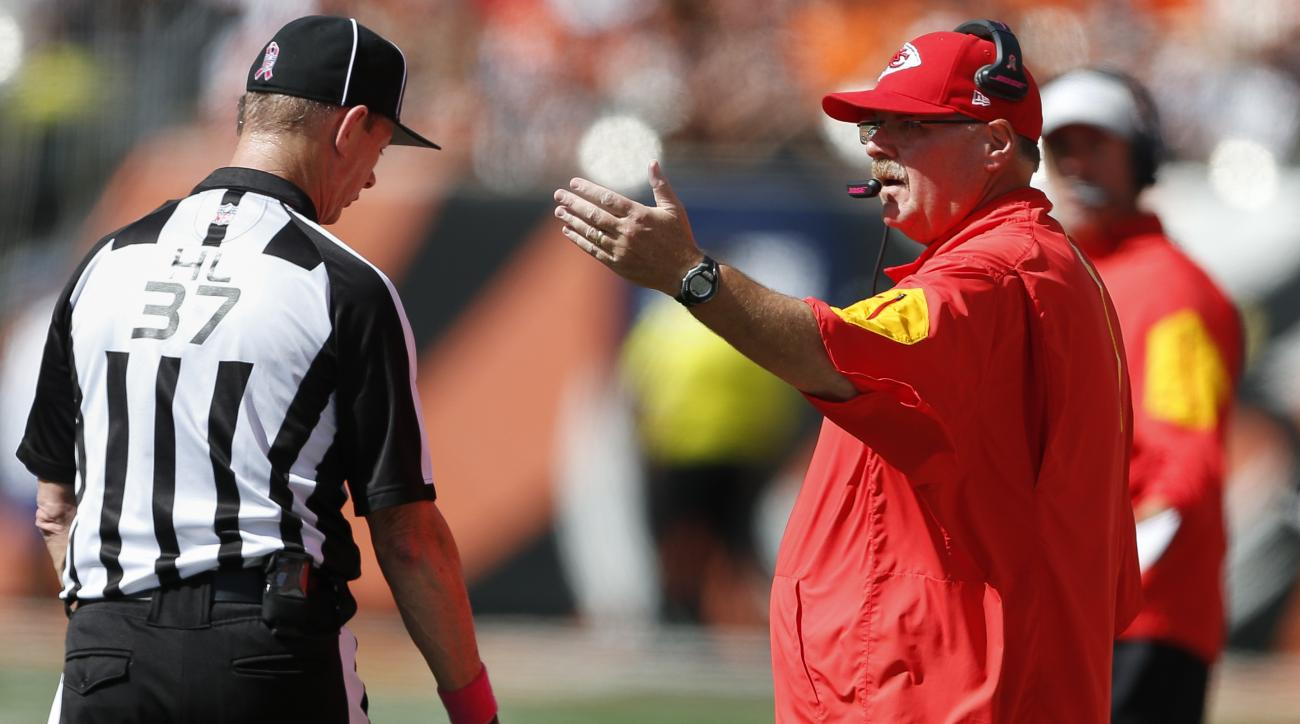 Kansas City Chiefs head coach Andy Reid, right, argues with head linesman Jim Howey (37) in the first half of an NFL football game against the Cincinnati Bengals, Sunday, Oct. 4, 2015, in Cincinnati. The Bengals won 36-21. (AP Photo/Gary Landers)
