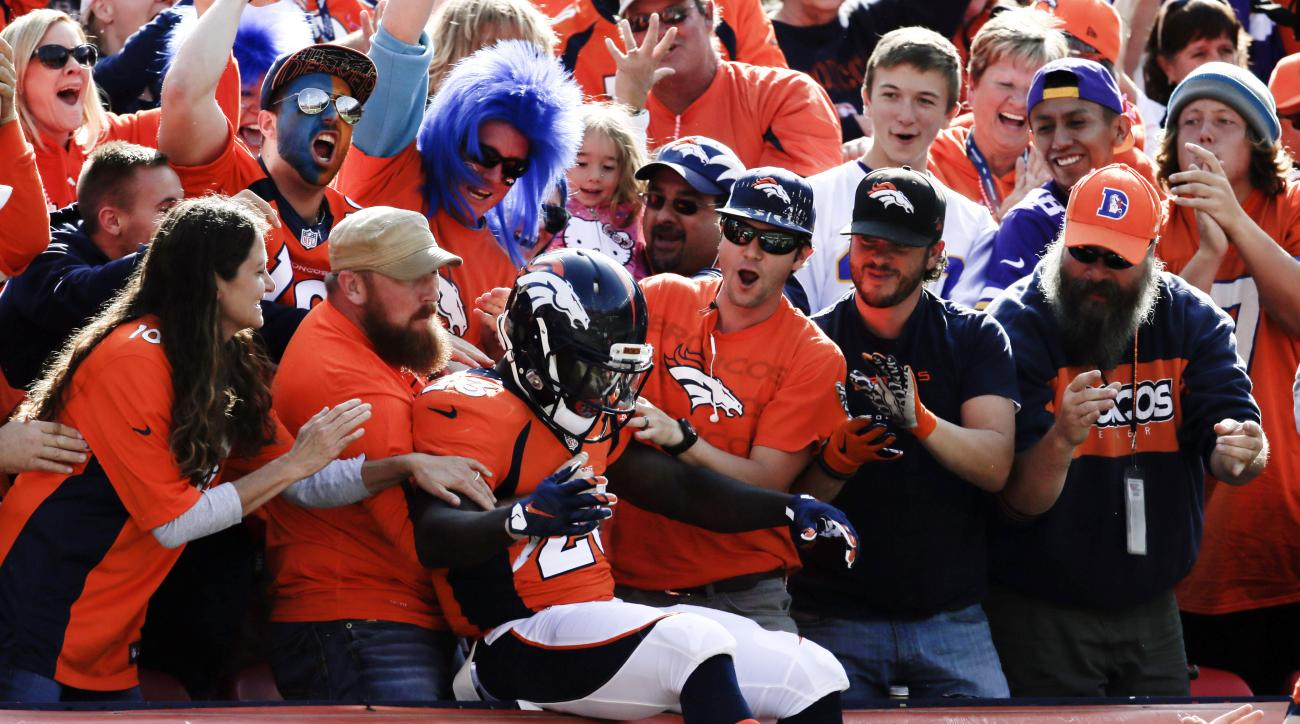 Denver Broncos running back Ronnie Hillman, center, celebrates after scoring against the Minnesota Vikings during the first half of an NFL football game Sunday, Oct. 4, 2015, in Denver. (AP Photo/Joe Mahoney)