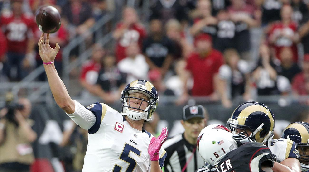 St. Louis Rams quarterback Nick Foles (5) throws against the Arizona Cardinals during the second half of an NFL football game, Sunday, Oct. 4, 2015, in Glendale, Ariz. (AP Photo/Ross D. Franklin)