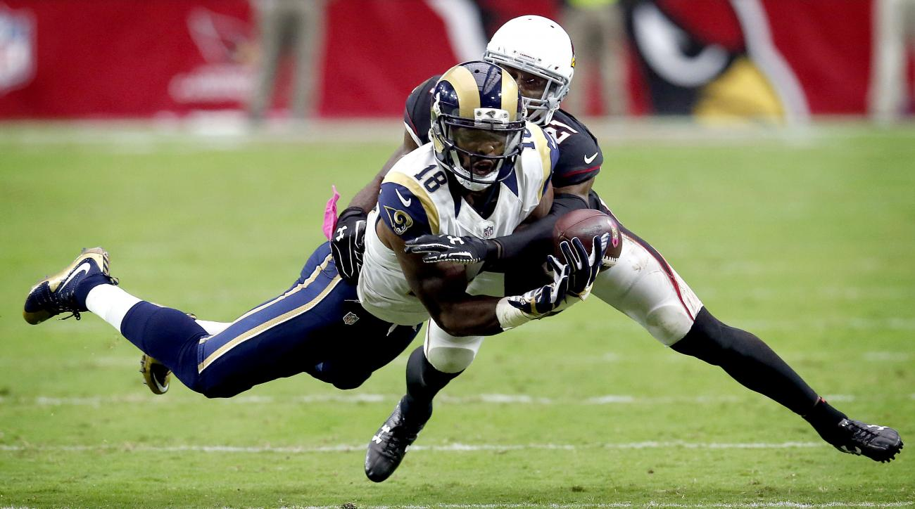 St. Louis Rams wide receiver Kenny Britt (18) can't hold on to the ball as Arizona Cardinals cornerback Patrick Peterson (21) defends an NFL football game, Sunday, Oct. 4, 2015, in Glendale, Ariz. The Rams won 24-22. (AP Photo/Rick Scuteri)
