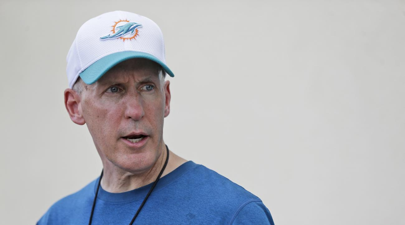 FILE - In this Aug. 4, 2015, file photo, Miami Dolphins head coach Joe Philbin speaks with members of the media at the team's NFL football training camp in Davie, Fla. Philbin was fired Monday, Oct. 5, 2015,  four games into his fourth season as coach of