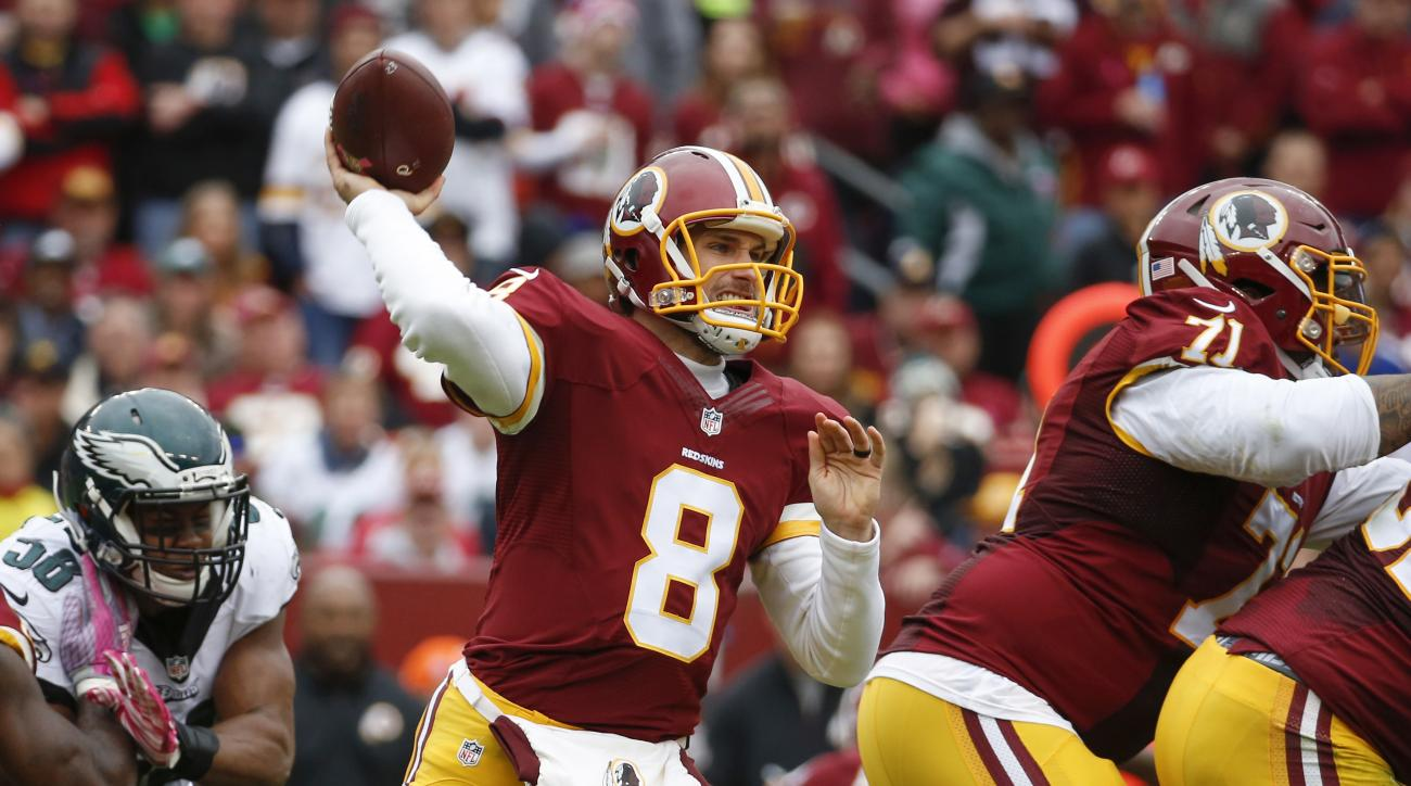 In  this photo taken Oct. 4, 2015, Washington Redskins quarterback Kirk Cousins (8) passes the ball during the first half of an NFL football game against the Philadelphia Eagles in Landover, Md. Kirk Cousins proved to himself, his head coach and his teamm