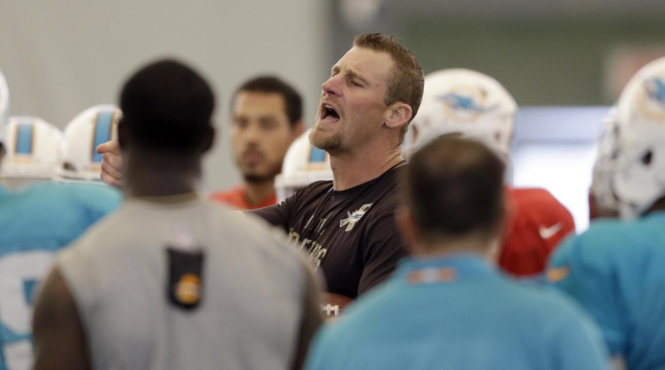 Miami Dolphins interim coach Dan Campbell gives instructions to players during an NFL football practice in Davie, Fla., Wednesday, Oct. 7, 2015. (AP Photo/Alan Diaz)