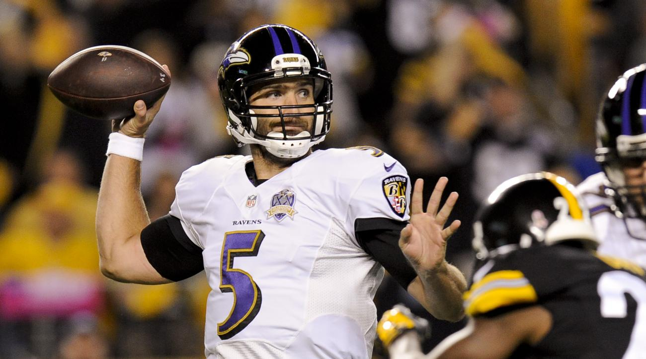 FILE - In this Oct. 1, 2015, file photo, Baltimore Ravens quarterback Joe Flacco looks to pass in the first half of an NFL football game against the Pittsburgh Steelers in Pittsburgh. The absence of two veteran receivers and his go-to tight end won't chan