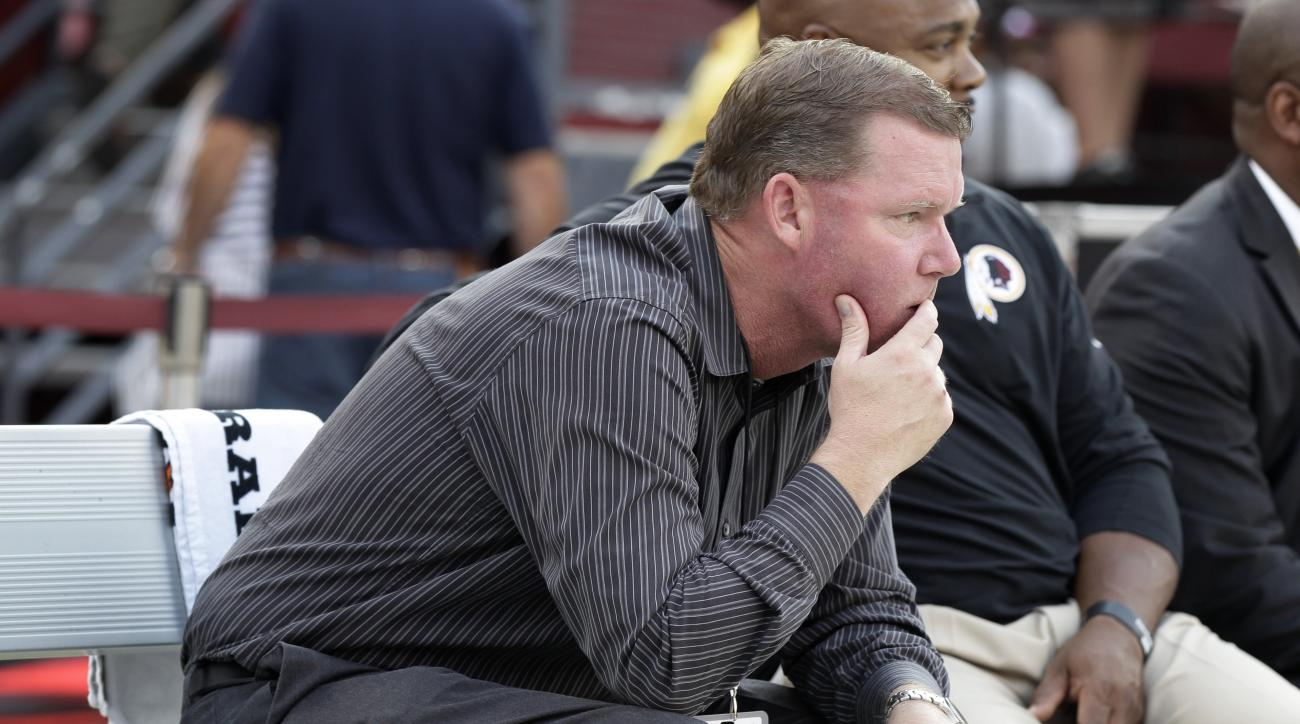 In this photo taken Sept. 3, 2015, Washington Redskins General Manager Scot McCloughan sits on the bench before an NFL preseason football game against the Jacksonville Jaguars in Landover, Md. The most talked-about and obvious move, of course, was the ben