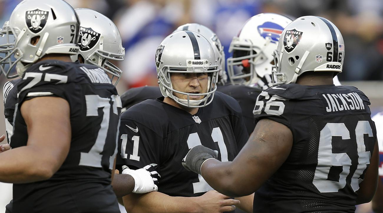 FILE - In this Dec. 21, 2014, file photo, Oakland Raiders place kicker Sebastian Janikowski (11) celebrates with teammates after kicking a 49-yard field goal against the Buffalo Bills during the third quarter of an NFL football game in Oakland, Calif.Jani