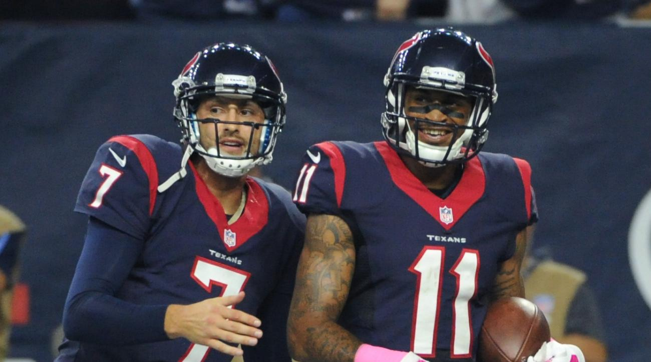 Houston Texans' Brian Hoyer (7) and Jaelen Strong (11) celebrates after they connected on a touchdown pass against the Indianapolis Colts during the second half of an NFL football game Thursday, Oct. 8, 2015, in Houston. (AP Photo/Eric Christian Smith)