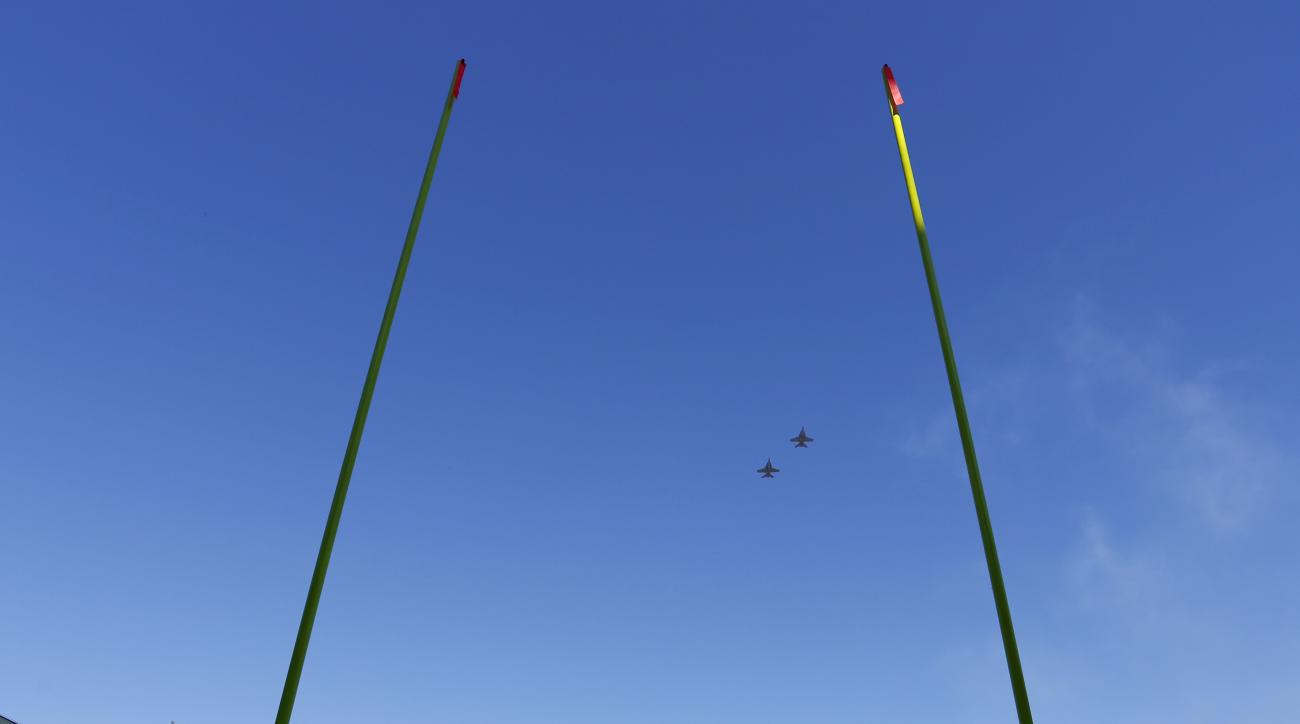 Plane do a fly over above Lambeau Field before an NFL football game between the Green Bay Packers and the St. Louis Rams Sunday, Oct. 11, 2015, in Green Bay, Wis. (AP Photo/Matt Ludtke)