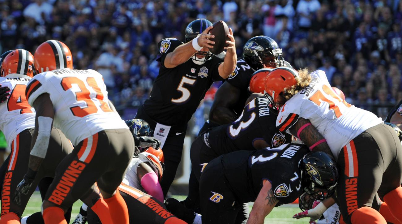 Baltimore Ravens quarterback Joe Flacco (5) leaps into the end zone for a touchdown in the second half of an NFL football game against the Cleveland Browns, Sunday, Oct. 11, 2015, in Baltimore. (AP Photo/Gail Burton)