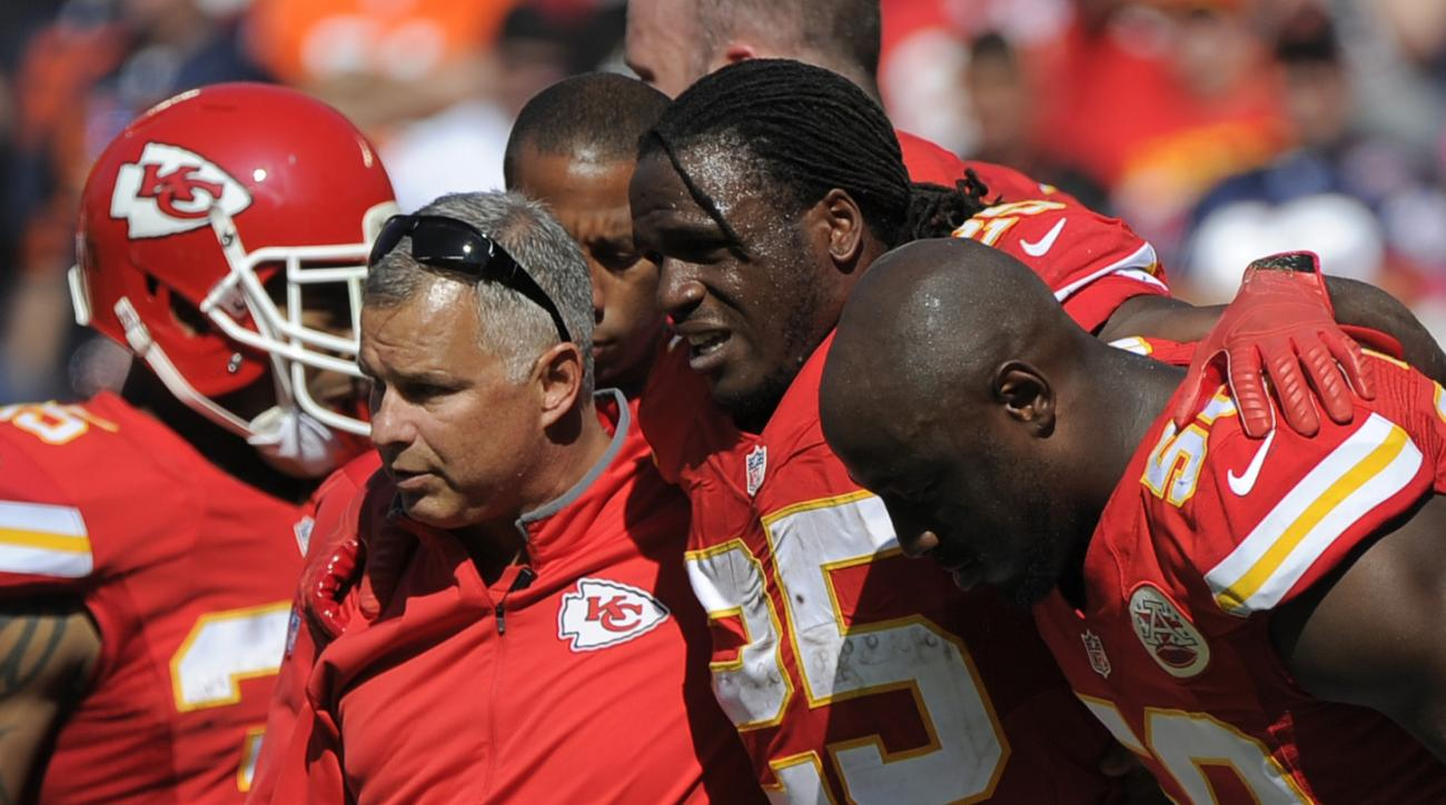 Kansas City Chiefs running back Jamaal Charles (25) is helped off the field after an injury in the second half of an NFL football game against the Chicago Bears in Kansas City, Mo., Sunday, Oct. 11, 2015. (AP Photo/Ed Zurga)