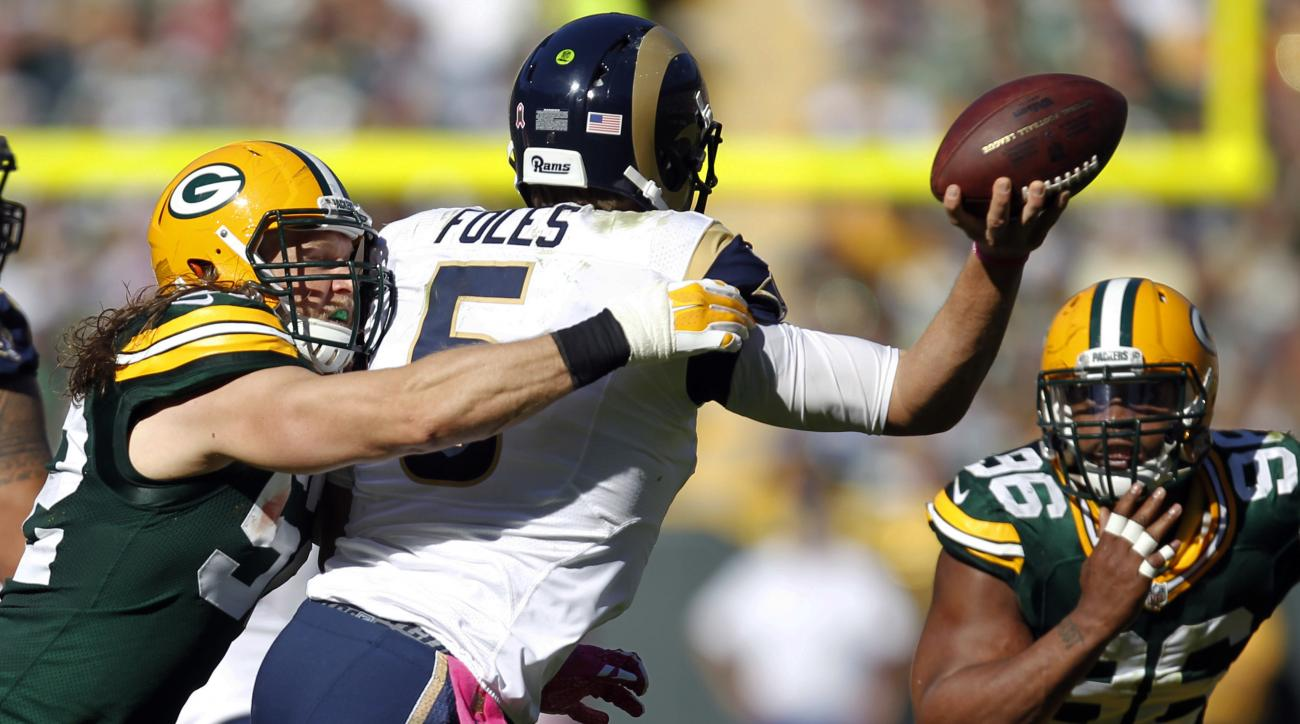 St. Louis Rams quarterback Nick Foles has to rush his throw while being pressured by Green Bay Packers' Clay Matthews (52) during the second half an NFL football game Sunday, Oct. 11, 2015, in Green Bay, Wis. (AP Photo/Matt Ludtke)
