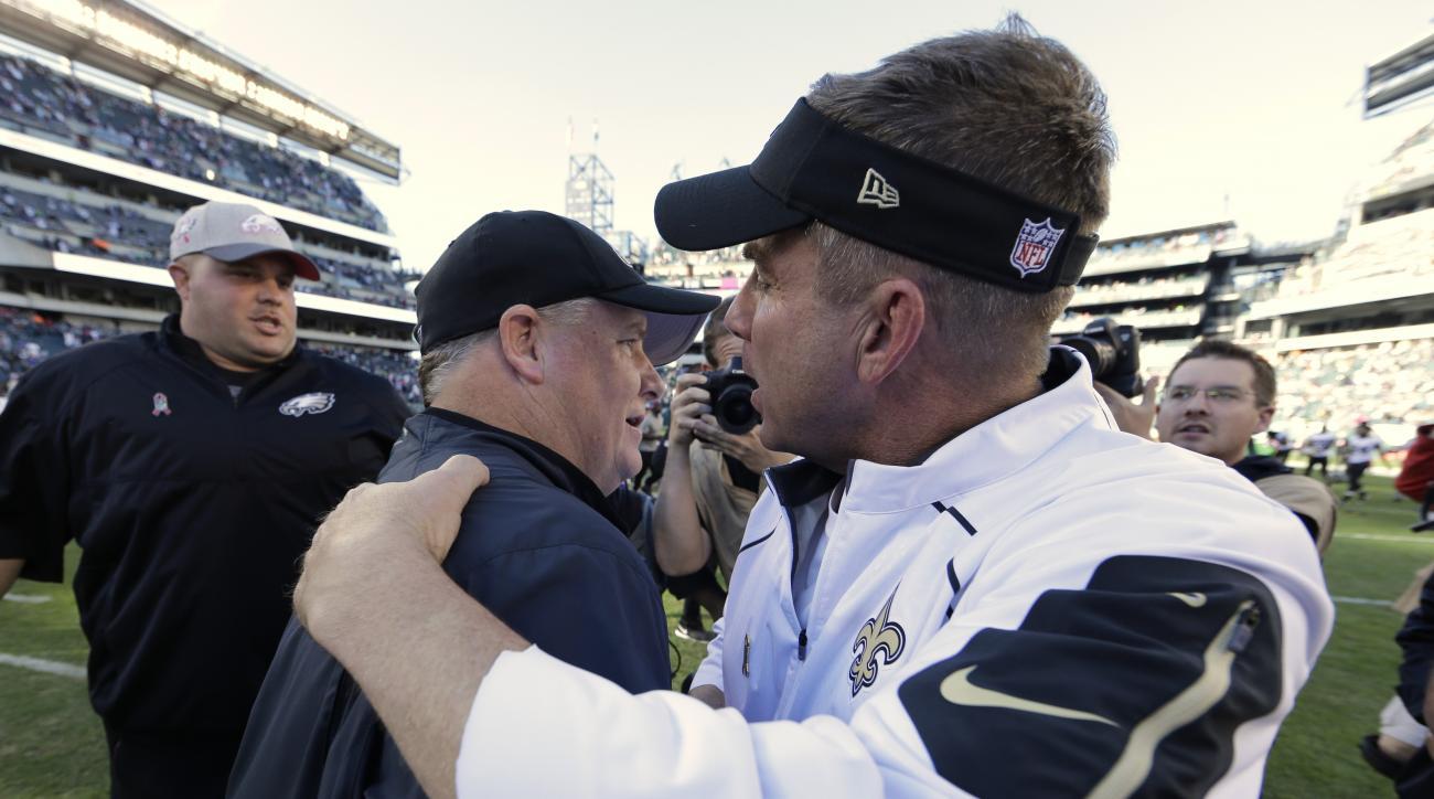 New Orleans Saints head coach Sean Payton, right, and Philadelphia Eagles head coach Chip Kelly meet after an NFL football game, Sunday, Oct. 11, 2015, in Philadelphia. Philadelphia won 39-17. (AP Photo/Matt Rourke)