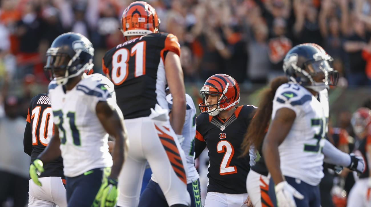 Cincinnati Bengals kicker Mike Nugent (2) celebrates after booting the winning field goal in overtime of an NFL football game against the Seattle Seahawks, Sunday, Oct. 11, 2015, in Cincinnati. The Bengals won 27-24. (AP Photo/Gary Landers)