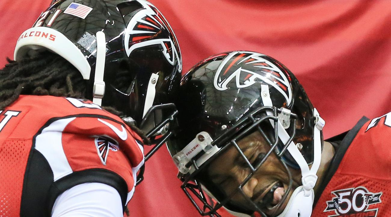 Atlanta Falcons cornerback Robert Alford, right, gets a head bump from Desmond Trufant in the end zone after he intercepted Washington Redskins quarterback Kirk Cousins in overtime and returned it for the game winning touchdown during an NFL football game